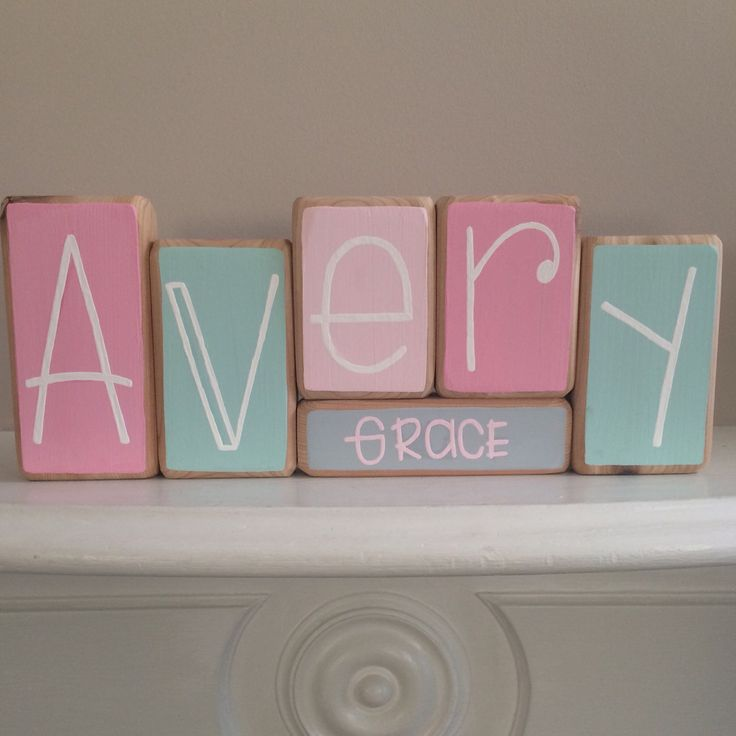 """These decorative blocks are the perfect addition to a baby's room! They can be given as a gift at a baby shower, after they are born, or you can order them for your own little one! Each block is solid wood with a hand-painted letter on the front. We can custom make them for any name in the colors of your choice.  The blocks range in height from 5, 6, and 7. They are 3.5 wide by 1.5"""" deep and the rectangular base allows them to stand on their own. HOW TO ORDER: 1. Select the Number of Blocks…"""