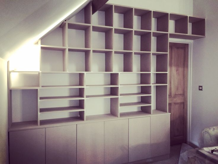 Bespoke eaves shelving and cupboards MDF, designed and made by Jane Handford Design