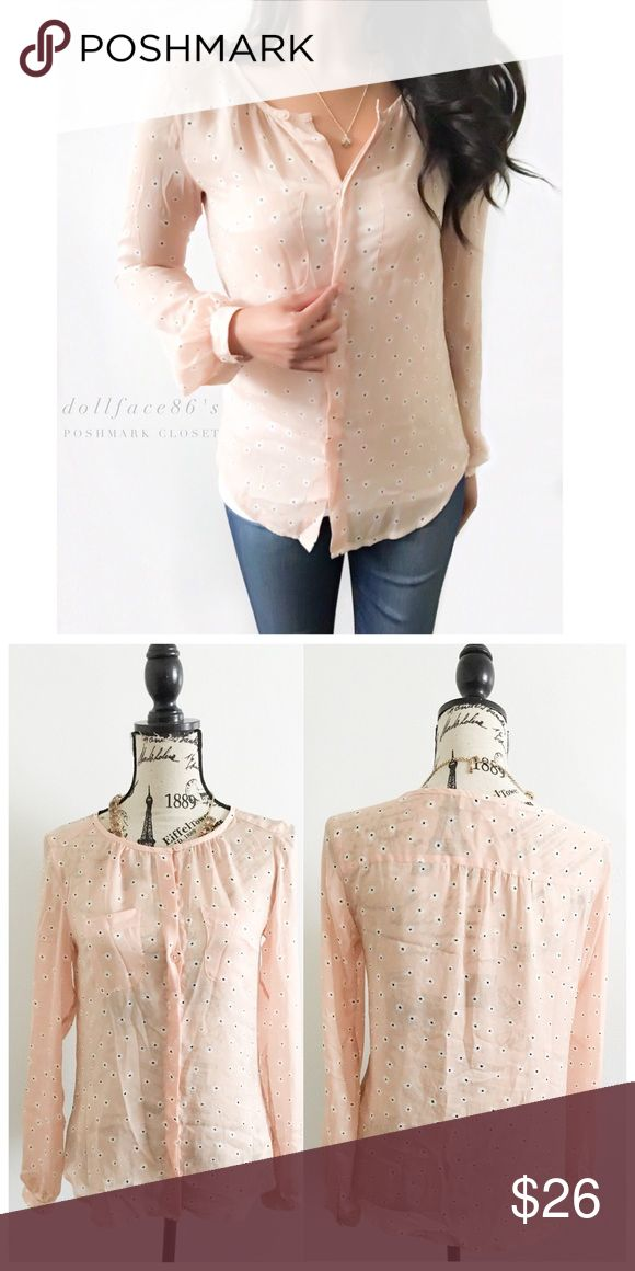 loft silky light pink white flower blouse this button down blouse has a silky fabric