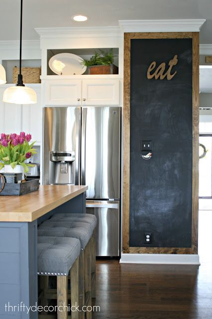 DIY on cleaning your stainless steel appliances - also check out the super cute chalkboard wall!