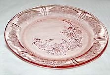 These are Depression Glass pink dinner plates in the Sharon or Cabbage Rose pattern that were made by Federal. They measure 9 inches across and are in very nice condition with no chips, cracks or usag