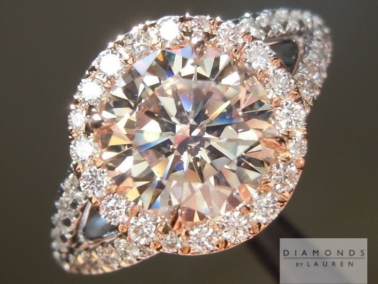 This is a champagne diamond engagement ring with a rose gold halo. To die for!  Diamonds by Lauren