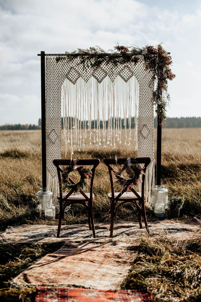 Stunning macrame arch with floral accents | Image by Chris and Ruth Photography