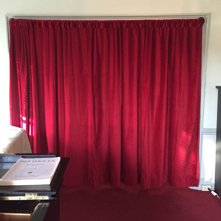 This is a Red 100% Belgium Cotton Velvet Panel Used as a Room Divider to Reduce Noise from traveling from room to room.