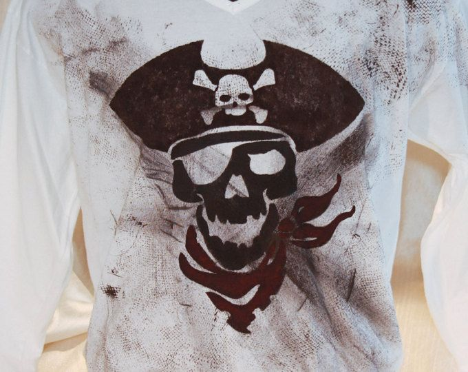 Browse unique items from NotYourUsualTee on Etsy, a global marketplace of handmade, vintage and creative goods. | Hand painted and hand stenciled men's t shirt featuring a pirate skull. Non-toxic, water based, permanent fabric colors.