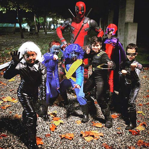 Popeye, The Rockford Peaches & More: The Best Celebrity Costumes of Halloween 2015 | RYAN REYNOLDS | The perks of being a movie star: Reynolds borrows his Deadpool costume for Fright Night.