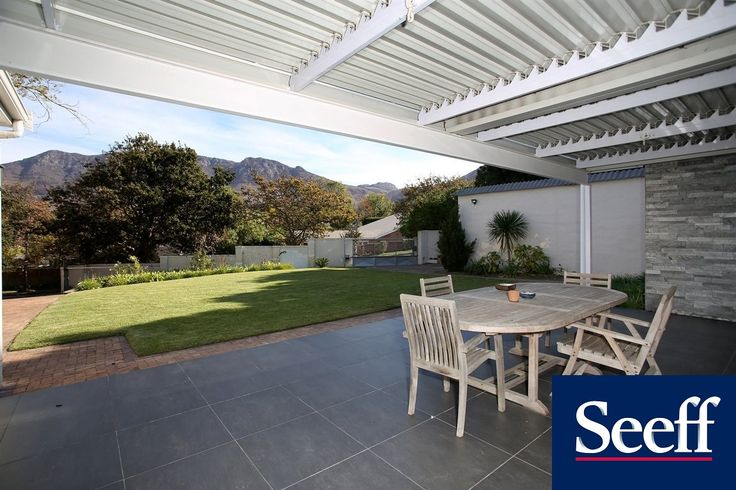 COUNTRY LIVING OFF KLEIN CONSTANTIA ROAD. Seller scaling down. Opportunity to enhance this great family home well positioned in popular Nova Constantia. There are 6 garages for the car enthusiast, 5 versatile reception rooms, swimming pool and an outdoor 2 roomed gym facing the pool. Stunning vineyard views from the front terrace.