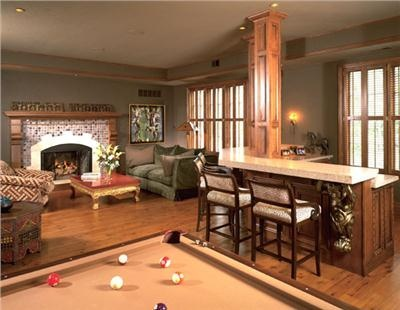 This bar artfully wraps around a support column! (Game Room by Julie O'Brien)