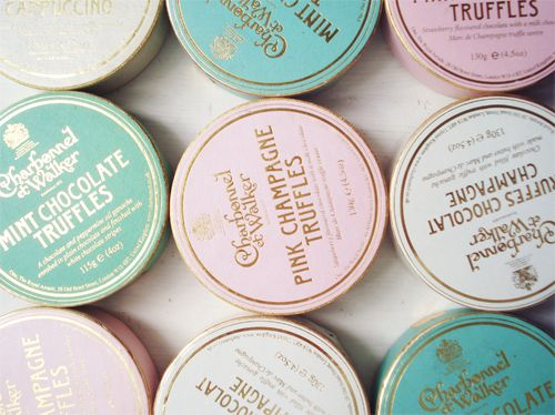 mint, champagne, and pink champagne truffles in perfect wedding favor boxes