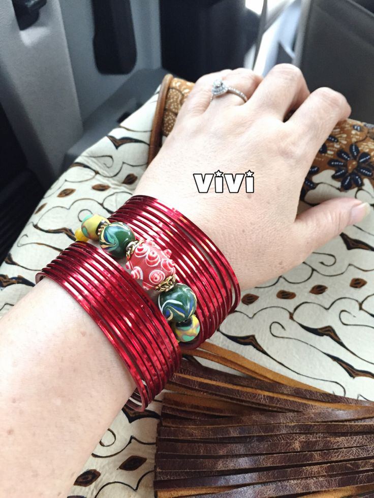 My eclectic style. India mix Indonesia: red glass bangles made in India & Jombang glass beads made Indonesia.