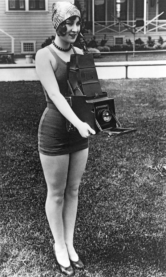 A Woman And Her Camera 20s era camera girl in bathing suit cap heels shoes found photo