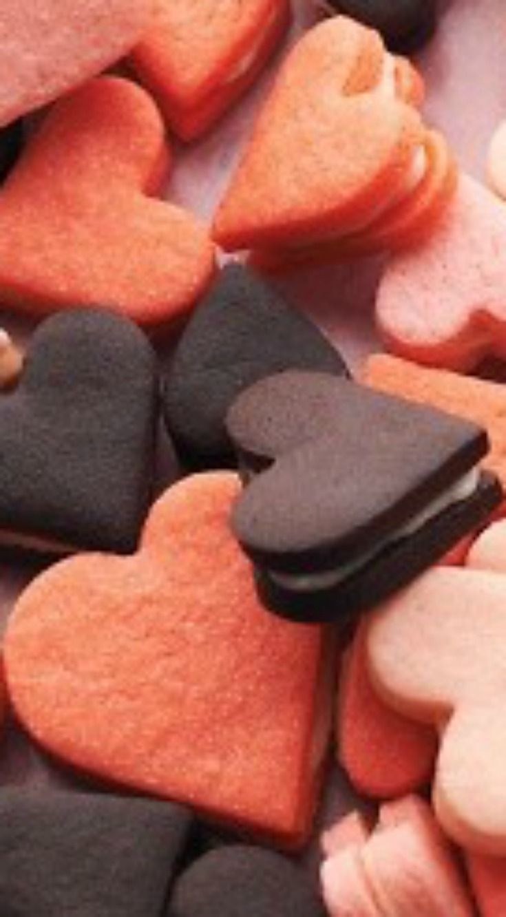Pink Heart Sandwich Cookies ~ The pink hearts are made from a sugar-cookie dough; the chocolate hearts are a little denser. What holds these charming sandwich cookies together is a filling that will remind you of an Oreo. It's creamy, but granulated sugar gives it a tender crunch.