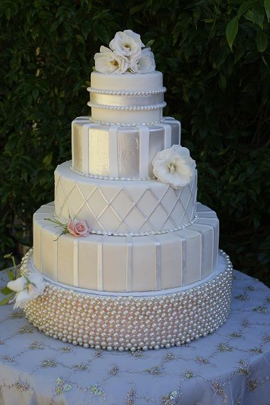 Silver and White wedding cake with 5 tiers