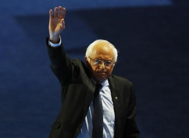 #NoDAPL Senator Bernie Sanders (D-VT) waves while leaving the stage after addressing the Democratic National Convention in Philadelphia, Pennsylvania, U.S. July 25, 2016. REUTERS/Scott Audette - RTSJMU9