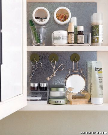 Organize your medicine cabinet by adding a sheet of galvanized steel and