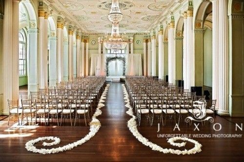 Simple, but elegant wedding ceremony set-up. Especially loving the petals lining the aisle.