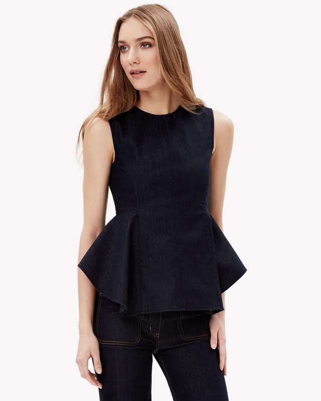 One of our defining silhouettes of the season, this sleeveless peplum shirt makes an ultra-feminine and modern statement with its princess seams and ruffled front skirt. This version in vintage-inspired denim gives it a slightly retro look yet still works with any short or pant.