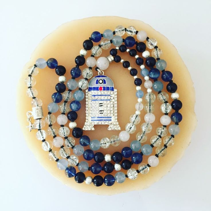 """R2D2 Mala! Hand-knotted with 108 stone beads and silver stardust accent beads. Blue Sandstone, Crackle Quartz, Blue Tourmaline, Aquamarine and White Jade. Hangs at about 22"""""""