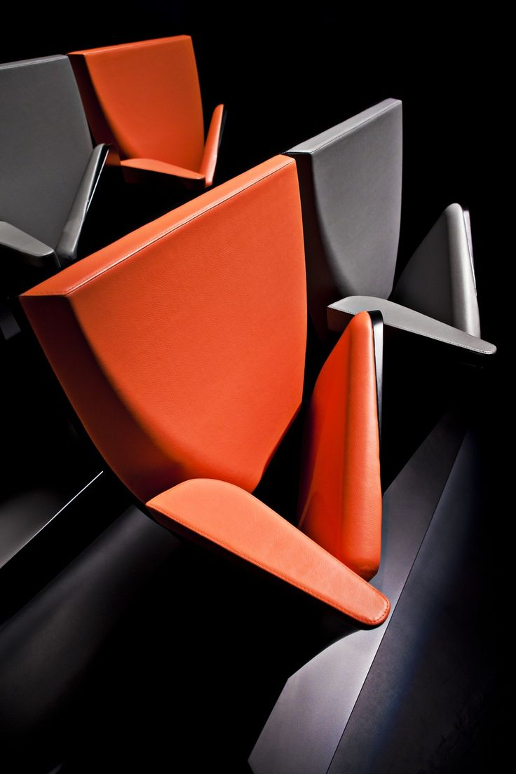 Zaha Hadid - Product - Array Auditorium Seating collaboration by Zaha Hadid Design for Poltrona Frau Contract. As a stand-alone piece, Array's design is driven by the seamless transition from a sculpted block of Euclidean geometry into a dynamic, twisting gesture