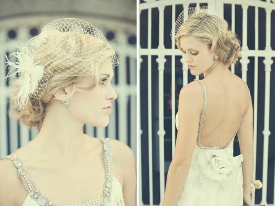 vintage wedding hair! Not so much with the netting but I like the loose curls.