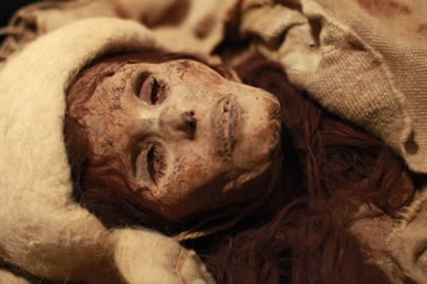 4000-YEAR-OLD Chinese mummy with red hair and kilt-like dress.  The origins of the mummy, known as the Beauty of Xiaohe, have been the subject of much debate since she was found in Xinjiang region in western China.  The bodies are better preserved than Egyptian mummies.
