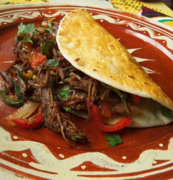Beef Machaca~ for breakfast, sauteed with onions and jalapeños, eggs and topped with fresh warm salsa. Accompanied by hot flour tortillas—the perfect Mexican breakfast.