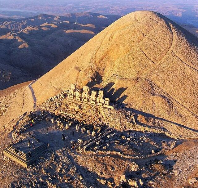 Nemrut or Nemrud is a 2,134 m (7,001 ft) high mountain in southeastern Turkey, notable for the summit where a number of large statues are erected around what is assumed to be a royal tomb from the 1st century BC. In Armenian legend, Hayk defeated the Biblical king Nimrod (equated with Bel) and buried him in these mountains. The conquering Arabs gave many ancient ruins they encountered the name Nimrud, including the famous Assyrian capital.