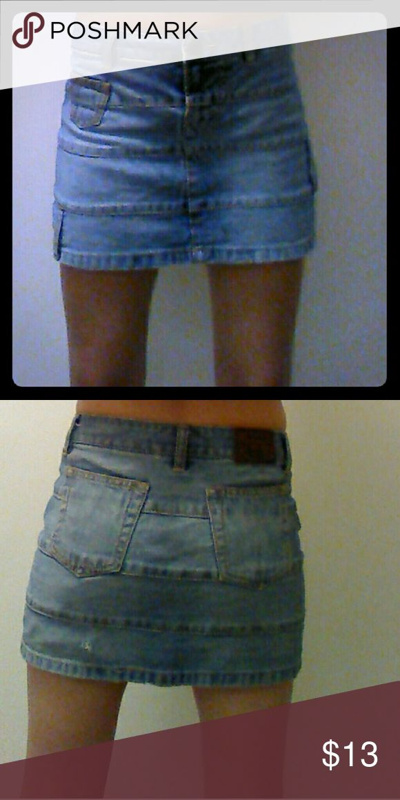 Tommy Hilfiger denim mini skirt Small hole on back bottom (as pictured) still cute! Tommy Hilfiger Skirts