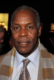 Danny Glover. I met him once at a party my Uncle Cedric had at his house and he was gracious enough to take a picture with me.  He was so soft-spoken and really a nice man!