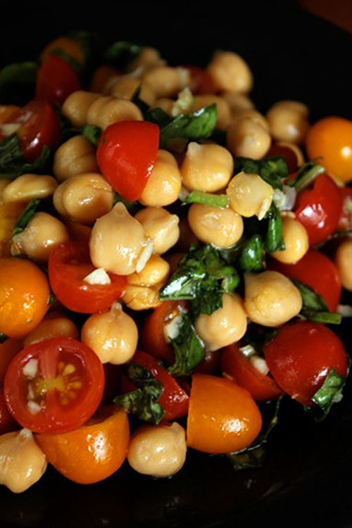 Chickpea and Tomato Salad with fresh Basil:   Ingredients  1 can chickpeas, drained and rinsed  About 1 pint grape tomatoes, halved  25 large basil leaves, chopped  3 cloves of garlic, minced  1 tbsp red wine vinegar  1 tbsp apple cider vinegar  2 tsp olive oil  1/2 tbsp honey (10g)  pinch of salt