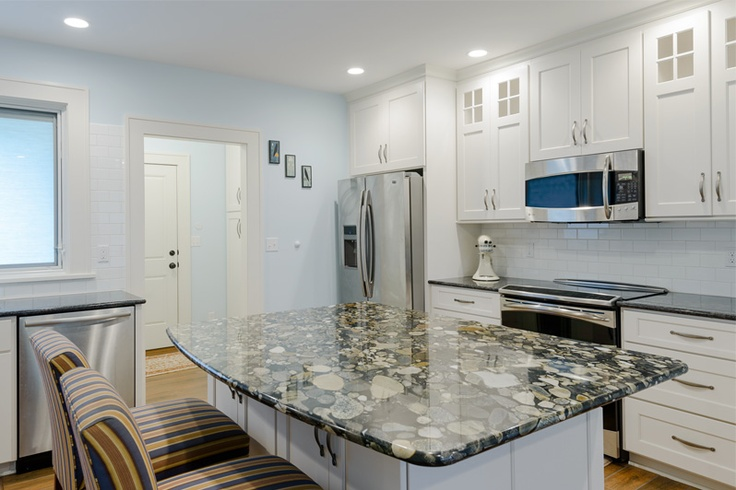 Swan Creek Cabinets: Kitchen island in Golden Marinace, perimeter countertops in Silver Pearl granite. (Design: Rich Lepper Construction;Swan Creek Cabinetry Co., Fab  Install: Renaissance; Photo: Tim Abramowitz)