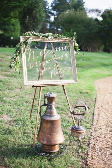 A glass framed wedding sign with olive branches. Source: Paper Lilly Photography. #weddingsigns