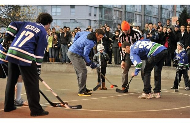 Vancouver Canucks locked out players Kevin Bieksa and Ryan Kesler join fans of all ages for a street hockey game on the basketball courts under the Cambie Street Bridge