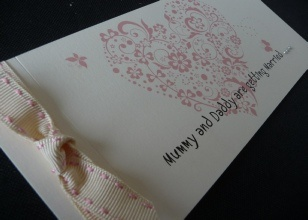 Pink Patterned Heart Cheque Book Style Invitation With Mummy Daddy Are Getting Married Wording