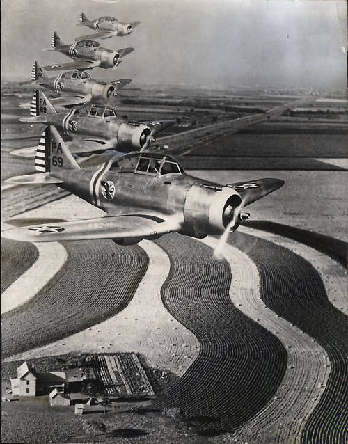 Fighting planes, carefully-tilled soil furnish two of the essentials to victory. 1943 photo that ran in the Atlanta Journal-Constitution showing World War II fighter planes flying in formation over a farm settlement and plowed fields. The source of photo is unknown; however, it was likely produced by U.S. government as part of the war effort.