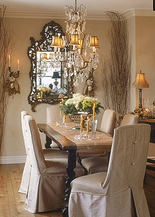 Love the elegance of these neutrals tones and the stylish light fittings and mirror.