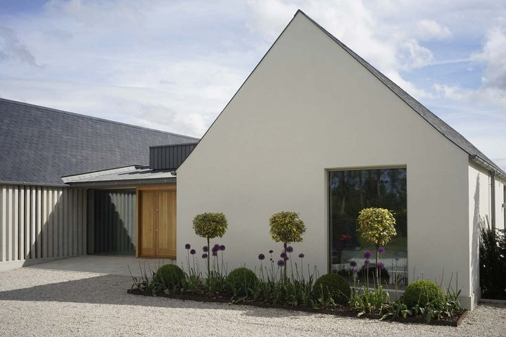 New build house in Co. Carlow, completed 2017. The H plan form, making two open courtyards, maximises light and views while placing the double height hallway at the heart of the house. The form of buildings echoes low eaved and grounded… – Teresa