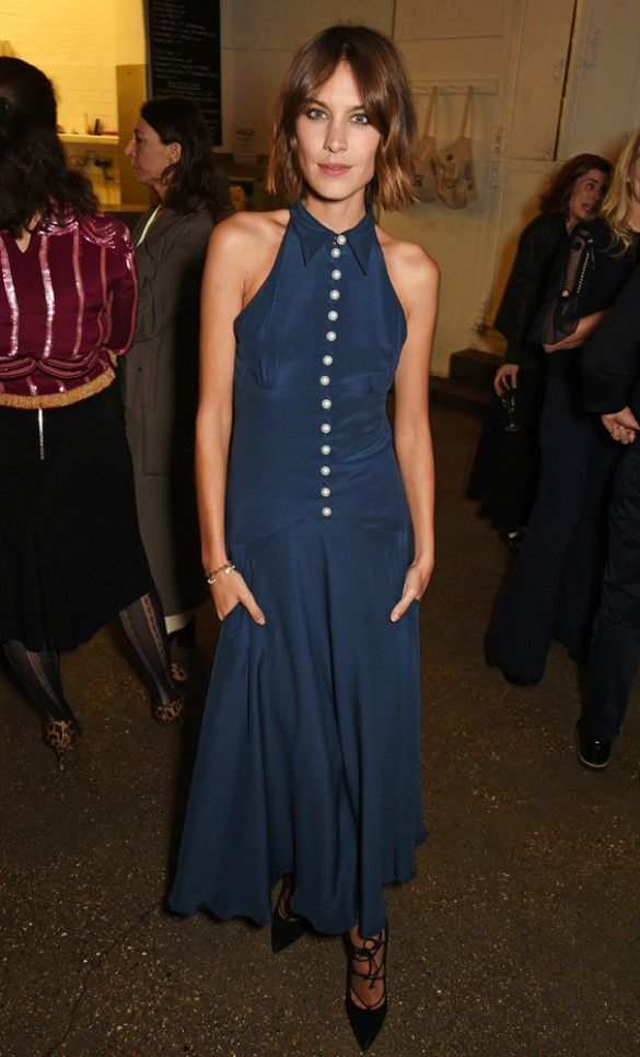 Alexa Chung wears a collared blue midi dress with pearl buttons and lace-up heels