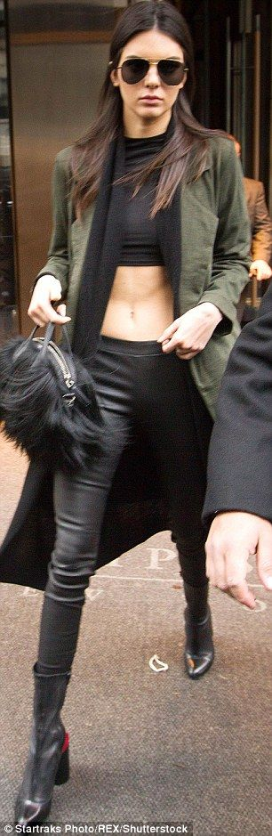 Not shy when it comes to showing off: The Vogue model was seen flaunting her toned tummy in a crop top and low-riding leather leggings
