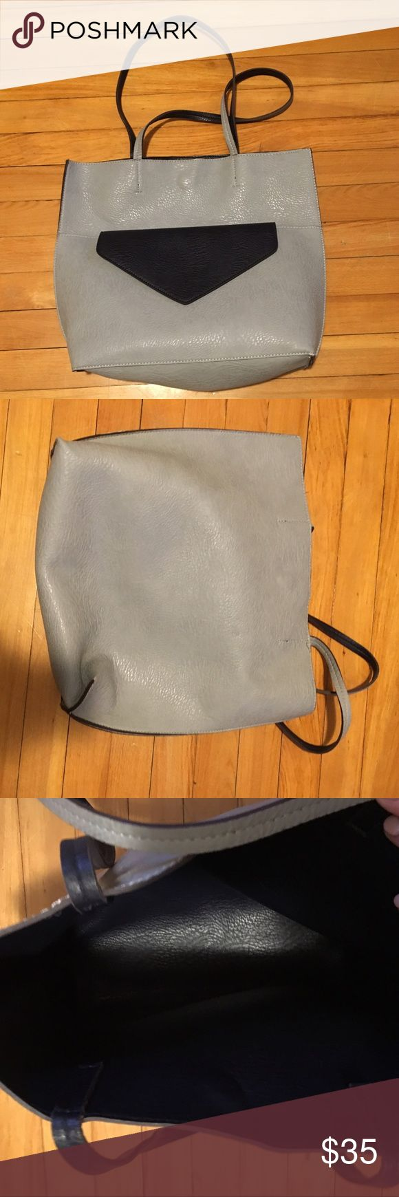 Gray and navy blue bag with detachable clutch Gray bag with navy lining. Gray pocket on outside with detachable navy clutch that fits inside the pocket. Great design and only used once or twice! Bags