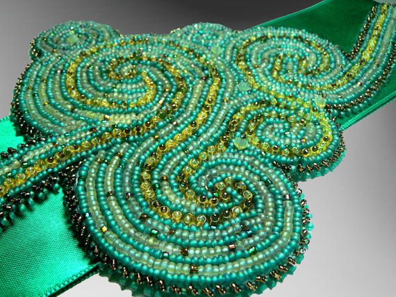 Green maze embroidered sash on Etsy, £46.40
