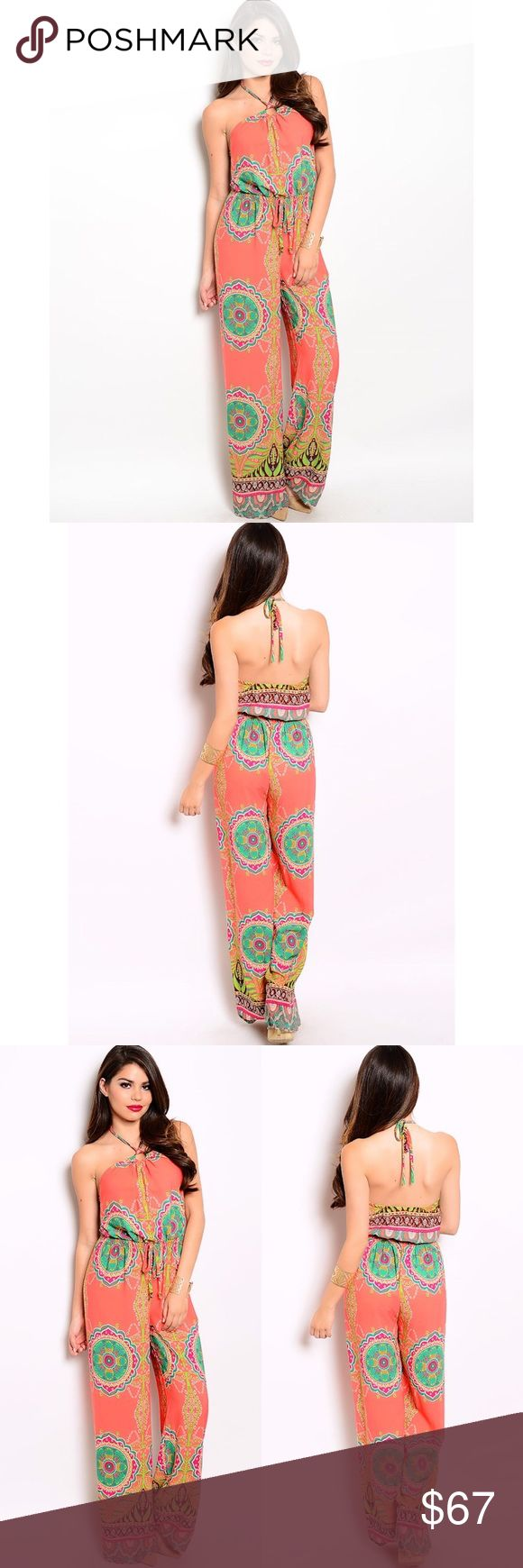 """ADRIENNE FLORALS JUMPSUIT CORAL GREEN BROWN JUMPSUITS This groovy jumpsuit channels 70s vibe with its wide-legged fit and colorful print. Strappy halter detail.   Country: USA Fabric Content: 100% POLYESTER  Description: L: 61"""" B: 16"""" W: 10"""" Other"""