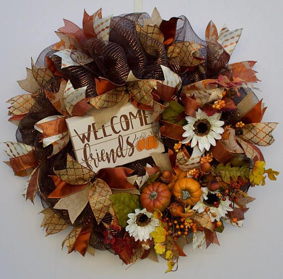 Its Fall Yall!! Pumpkins, falling leaves and a time to give thanks. Nothing says Harvest like this classic fall deco mesh wreath. This beautiful handmade wreath is created with dark brown deco mesh woven with a metallic foil that will glisten in the fall sun and 6 different coordinating ribbons. All of the ribbon is wired for easy fluffing after those windy fall days. Additional materials include premium silk fall leaves, faux mini pumpkins, squash premium white silk sunflowers and assorted…