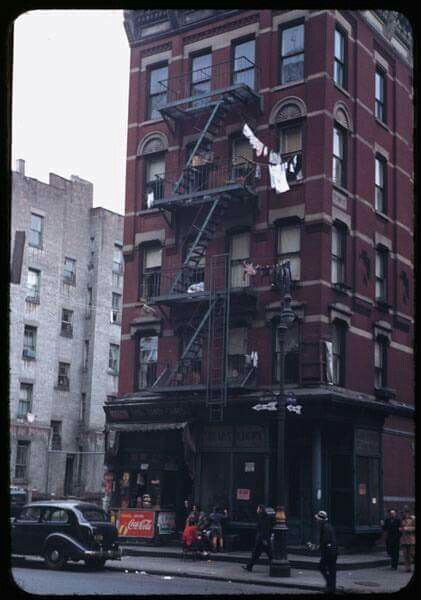 1942, Oct. N.W. corner of Delaney and Lewis. Street scene showing a neighbor store, a butcher who has vacated and now a store for rent sign, residents with their children, getting some fresh air, their hanging wash and pedestrians, so NYC. Charles Cushman photog. http://webapp1.dlib.indiana.edu/cushman/results/detail.do;jsessionid=95640BE724F68CDF286AA73C13D07532?query=year:1942&page=5&pagesize=20&display=thumbcap&action=browse&pnum=P02688