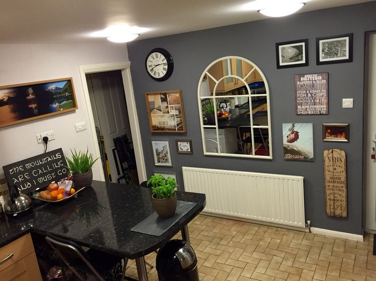 Kitchen feature wall in Crown City Break and Spotlight paints. Art wall and large mirror for light