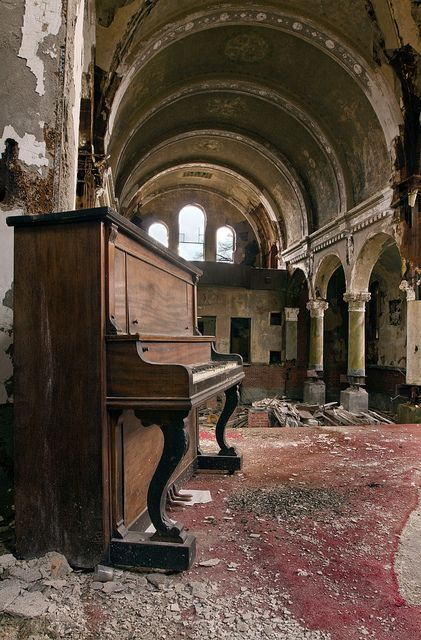 Abandoned St. Joseph Byzantine Church in Cleveland, Ohio. The red carpet is a striking contrast to the ruin around.