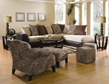 Perfect Avenue Living Room Group Includes: Sectional Coffee Table 2 End Tables 2  Lamps 2 Cube Ottomans This Set Features Zebra Print Accents.