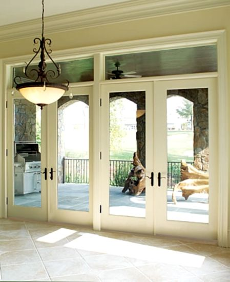 Patio doors-would like a diff door style but def like the transom window above the doors!