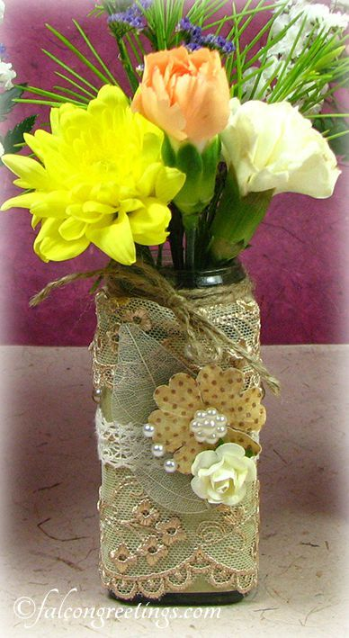Transform a small glass jar into a pretty flower vase with just a bit of glue, lace, a twine and embellishments.