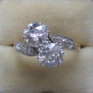 Diamond two stone twist engagement ring